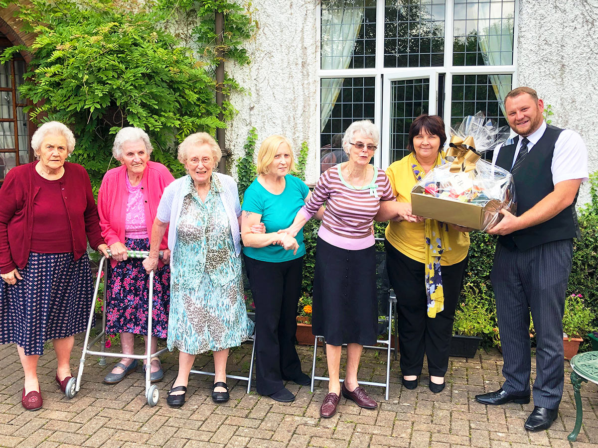 Stuart presents a hamper to Redcote Care Home (1st August 2019)